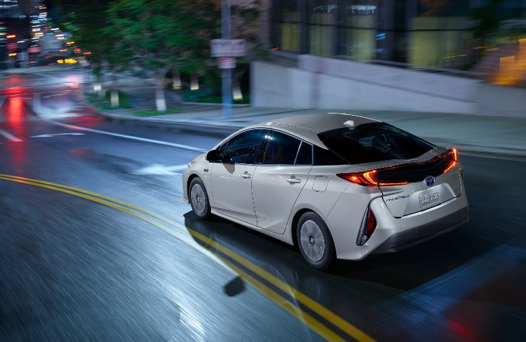 2021 Toyota Prius Prime driving towards a stop and go light