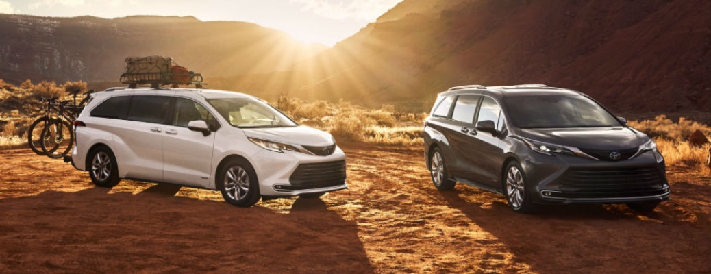 Two 2021 Toyota Sienna vans with sunset in the background