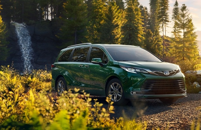 2021 Toyota Sienna parked in front of a waterfall