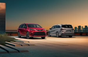 Two 2021 Toyota Sienna minivans parked next to each other