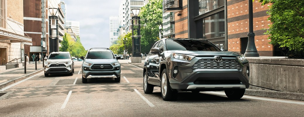 Three 2021 Toyota RAV4 crossovers going down the street