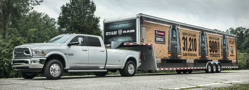 2018 RAM Heavy Duty silver side towing trailer