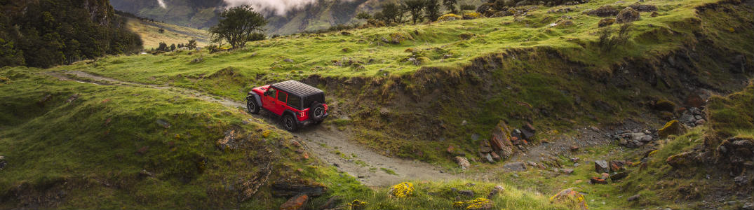 2018 Jeep Wrangler far view driving up hill