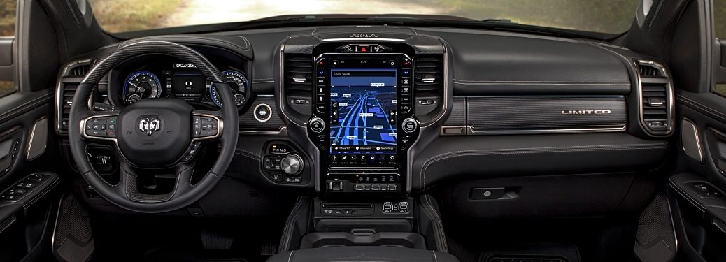 2019 RAM 1500 black interior with a 12-inch touchscreen