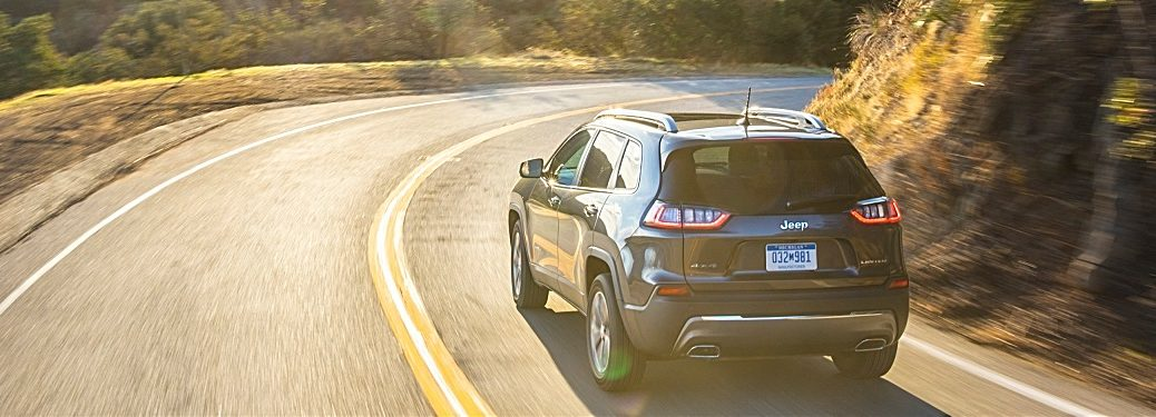 2019 Jeep Cherokee black back view on the road