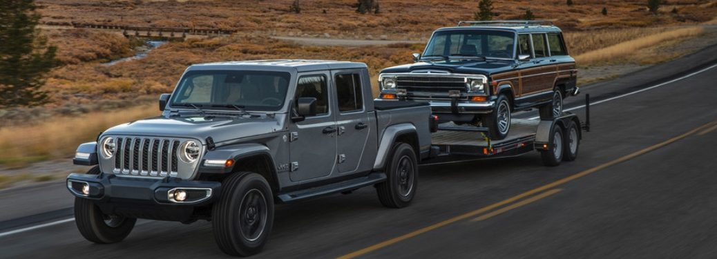 2020 Jeep Gladiator towing a Wagoneer gray side view