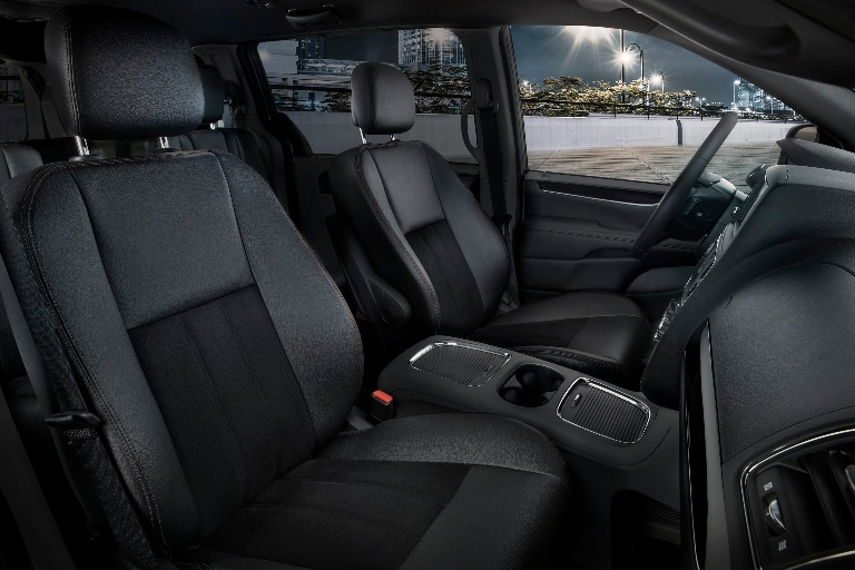2019 Dodge Grand Caravan driver and passenger seats with big city through driver side window