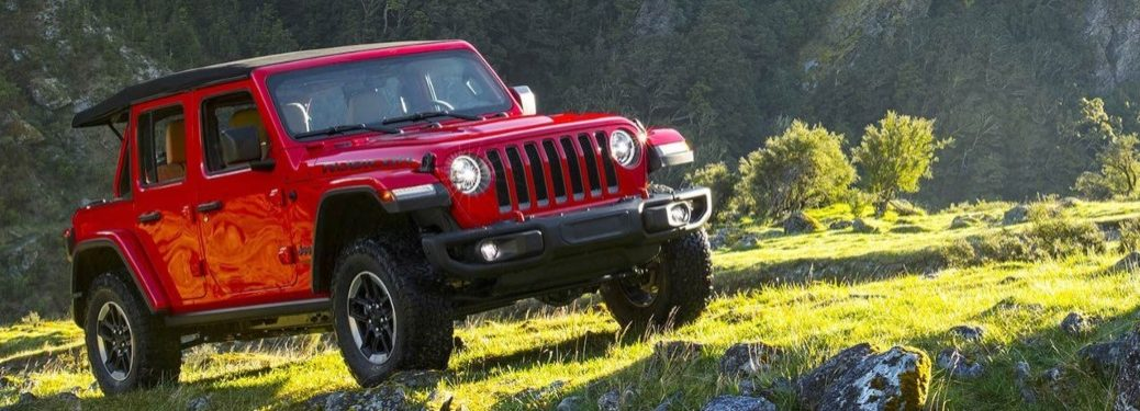 2019 Jeep Wrangler red side view on grass
