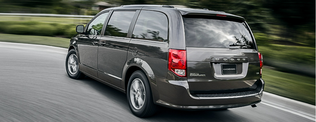 Driver's side rear angle view of grey 2020 Dodge Grand Caravan