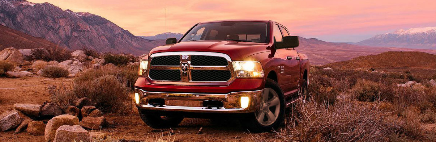 Red 2020 RAM 1500 Classic parked on rocky terrain