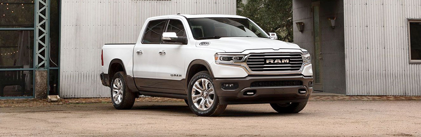 Passenger's side front angle view of white 2020 RAM 1500