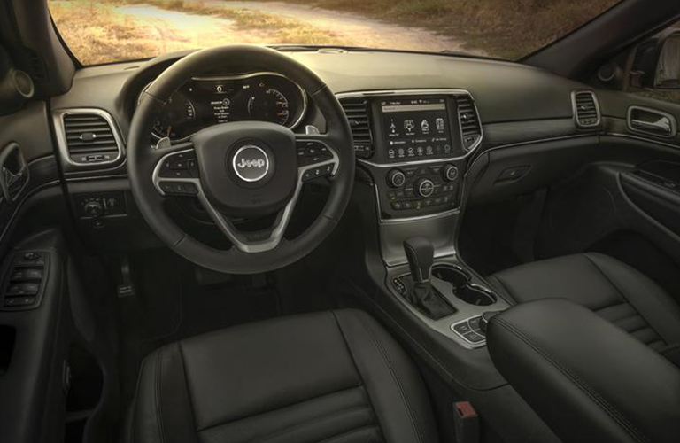 Steering wheel, gauges, and touchscreen in 2020 Jeep Grand Cherokee