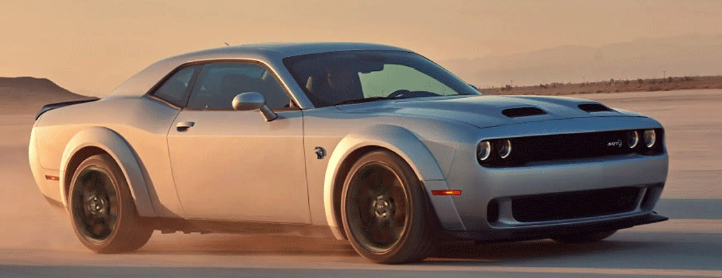 2021 Dodge Challenger driving through sand