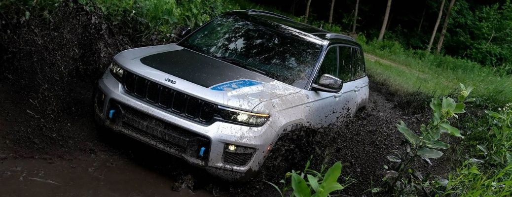 A 2022 Jeep Grand Cherokee 4xe being driven in a thick jungle