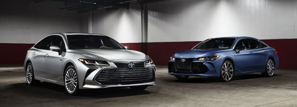 Side exterior view of a gray and a blue 2019 Toyota Avalon