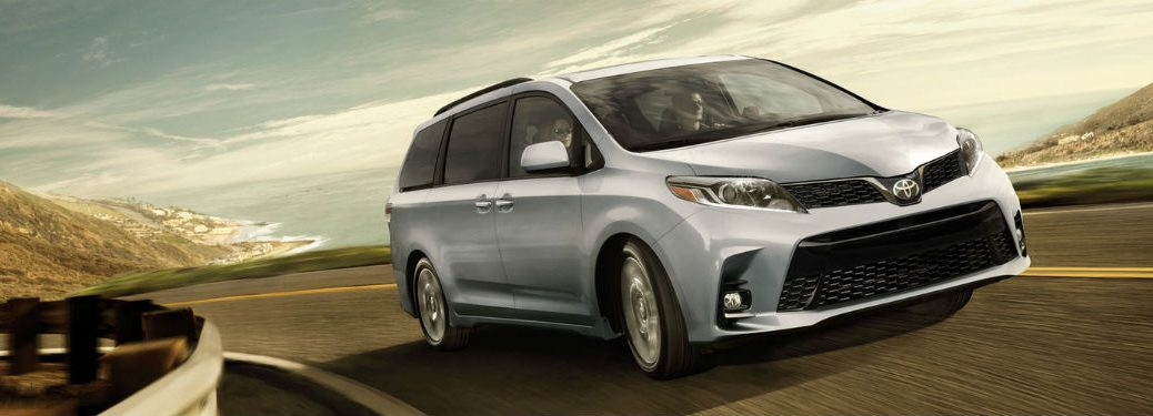 Passenger side exterior view of a gray 2018 Toyota Sienna