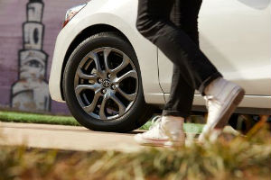 2019 Toyota Yaris exterior view of drivers side wheel person walking next to it