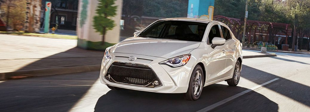 2019 Toyota Yaris exterior front fascia and drivers side driving on town road