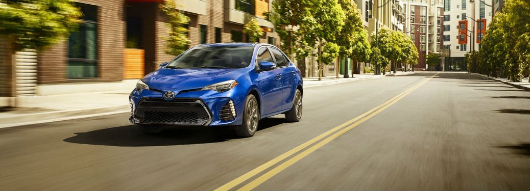 2019 Toyota Corolla exterior front fascia and drivers side going fast on road