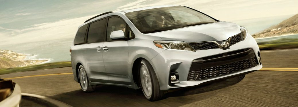 2019 Toyota Sienna exterior front fascia and passenger side going fast on road