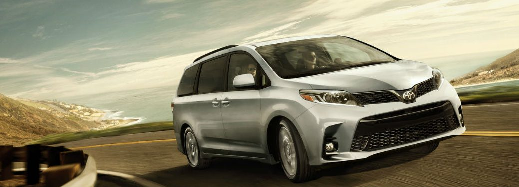 2019 Toyota Sienna exterior front fascia and passenger side going fast on blurred road