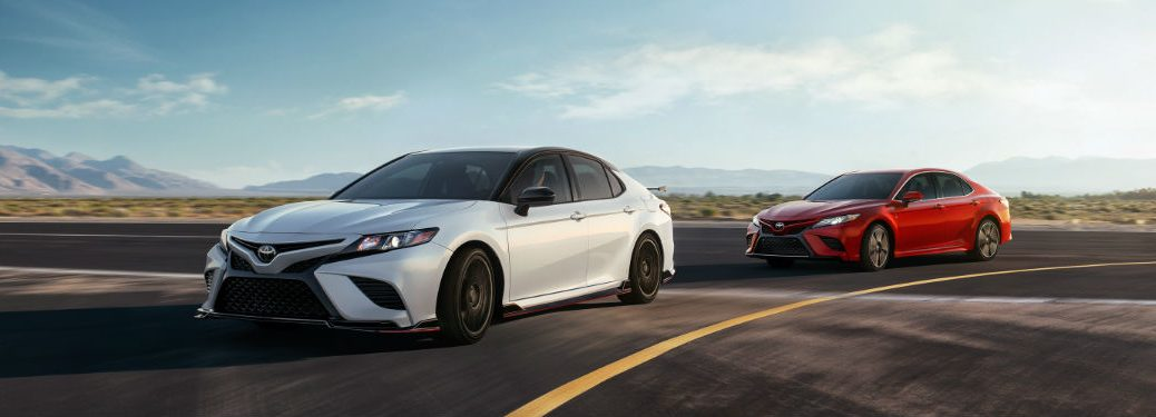 Two 2020 Toyota Camry cars driving on a road