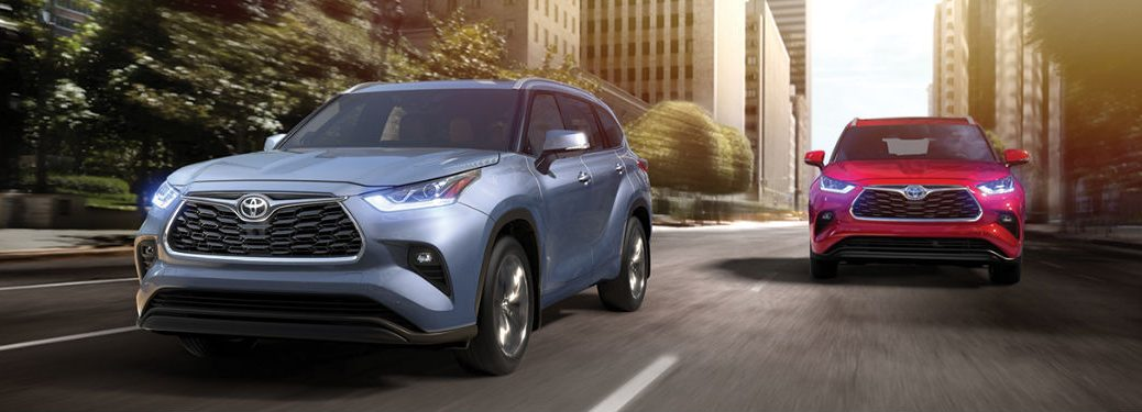 Two 2020 Toyota Highlander crossover SUVs driving on a road