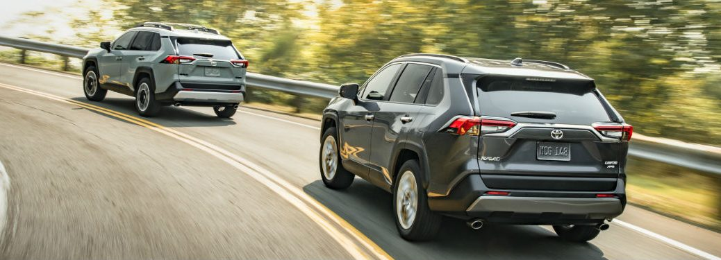 Two 2020 Toyota RAV4 crossover SUVs driving on a road