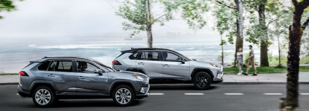 Two 2021 Toyota RAV4 crossovers driving on a road
