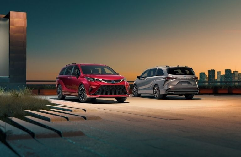 2021 Toyota Sienna Cars White and Red in Parking Space