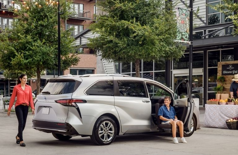 2021 Toyota Sienna parked and power lift up seat is being used by the co-passenger in the front