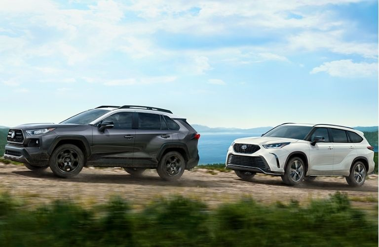 Two Toyota SUVs on the road