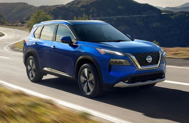 Nissan Rogue moving fast on a highway