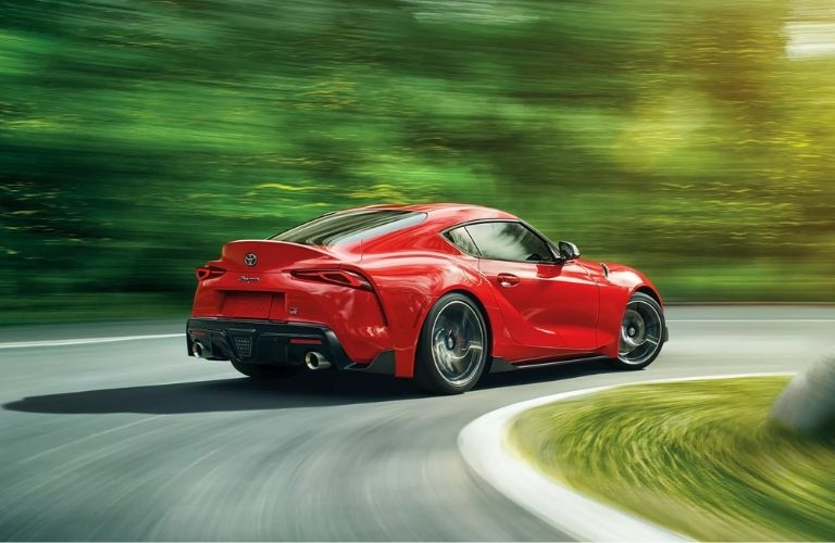 rear-view of the 2022 Toyota GR Supra racing through the road