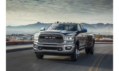 2019 Ram 3500 Heavy Duty limtied crew cab exterior shot driving down a barren country highway