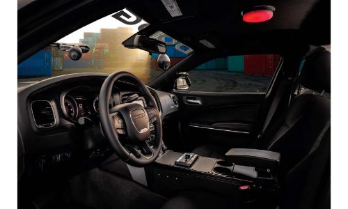 2020 Dodge Charger Pursuit interior side shot of front seating upholstery, steering wheel, and dashboard materials and layout