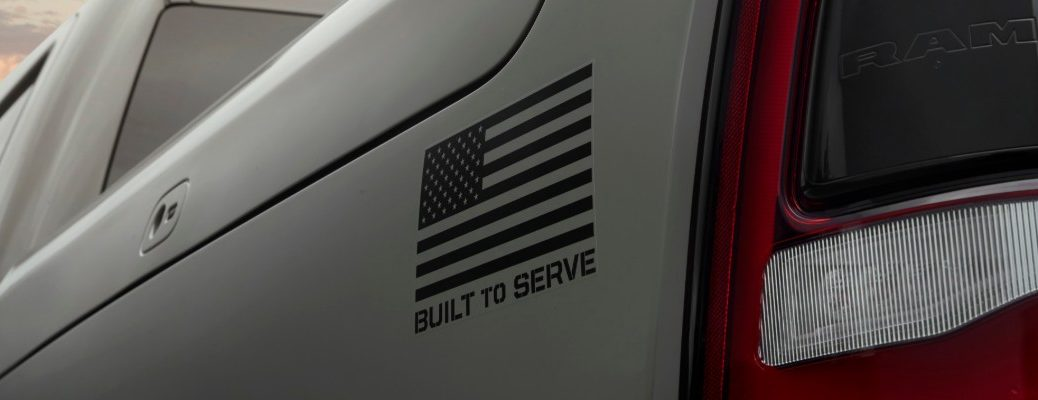 2020 Ram 1500 Built to Serve Edition exterior close up of American flag badging near taillight