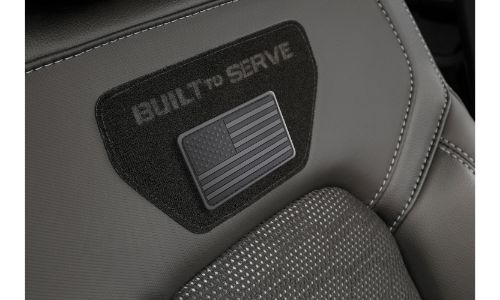 2020 Ram 1500 Built to Serve Edition interior shot of front seating with American flag and catchphrase stitched badging