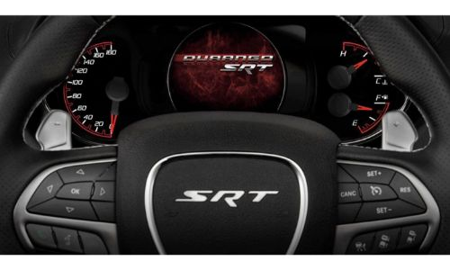 2020 Dodge Durango SRT interior shot close up of steering wheel with dials and middle screen showing make and trim level logo