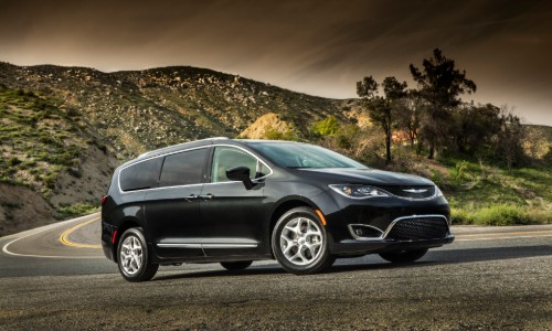 2020 Chrysler Pacifica Touring L Plus exterior side shot with black paint color parked on a country road