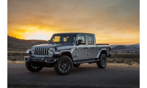 2020 Jeep Gladiator pickup truck exterior shot with billet silver metallic paint color parked in the wilderness at sunset