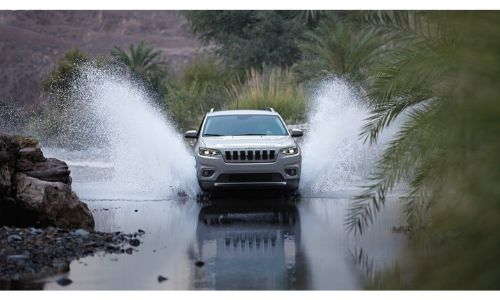 2020 Jeep Compass driving through water