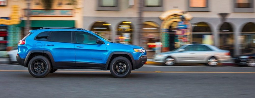 2020 Jeep Compass Blue exterior driving down city street