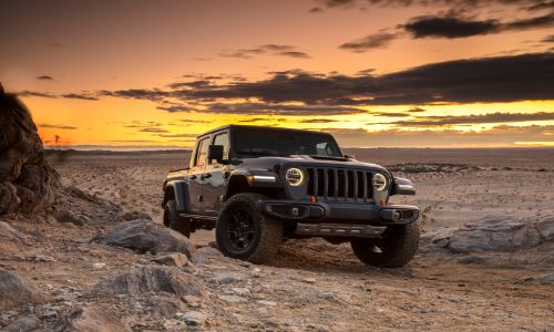 2020 Jeep Gladiator Mojave exterior shot parked on a rocky plain in a desert as the sun sets