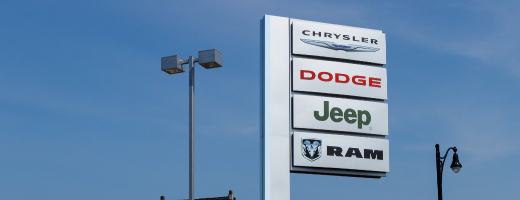 Chrysler, Dodge, Jeep, and Ram automotive car dealership sign in the sky