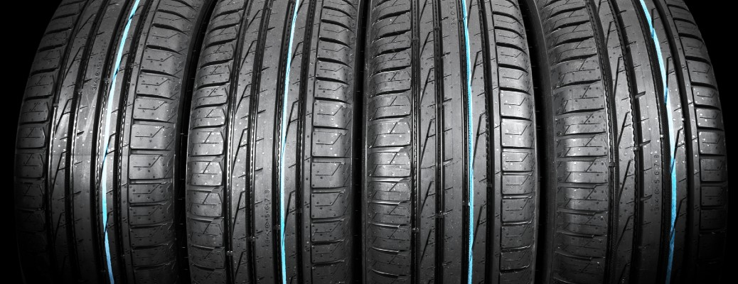 a line shot of a set of summer vehicle tires and their tread patterns