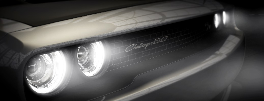 2020 Dodge Challenger 50th Anniversary Commemorative Edition exterior close up of LED headlights and grille badge