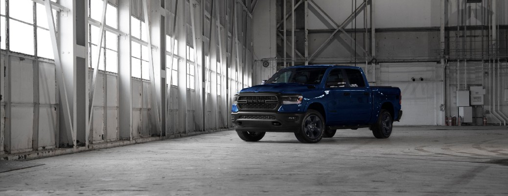 2020 Ram 1500 Built to Serve Edition truck model in blue parked in an empty vehicle hangar