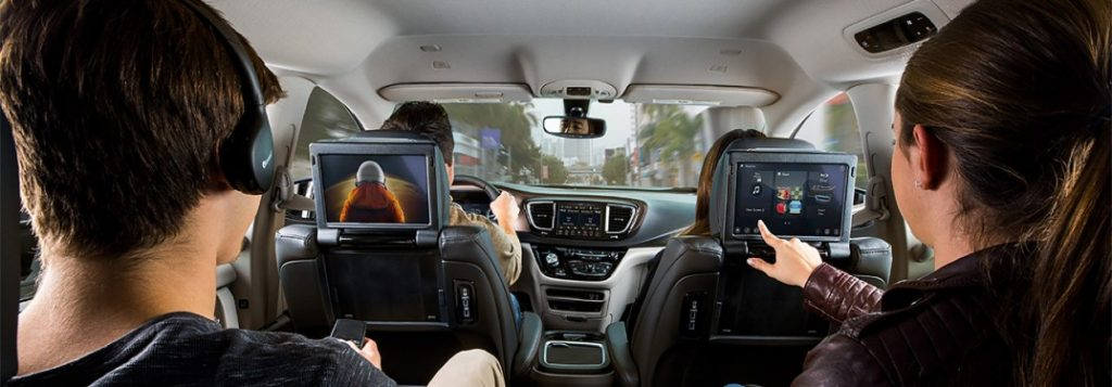 Teens using the Uconnect Theater inside the 2021 Chrysler Pacifica