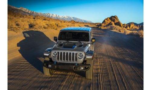 2021 Jeep Wrangler 4xe exterior front shot driving on a desert road